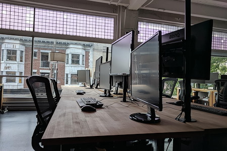 Strange Loop Games - Desk in open co-working office