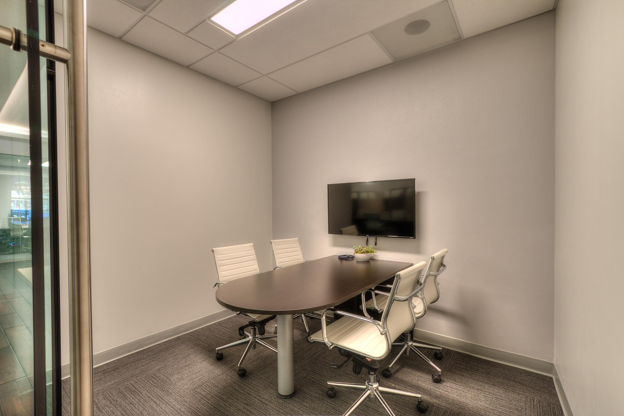 private meeting room for 4 at kennedy s realty international rh liquidspace com small meeting room table small meeting rooms near me