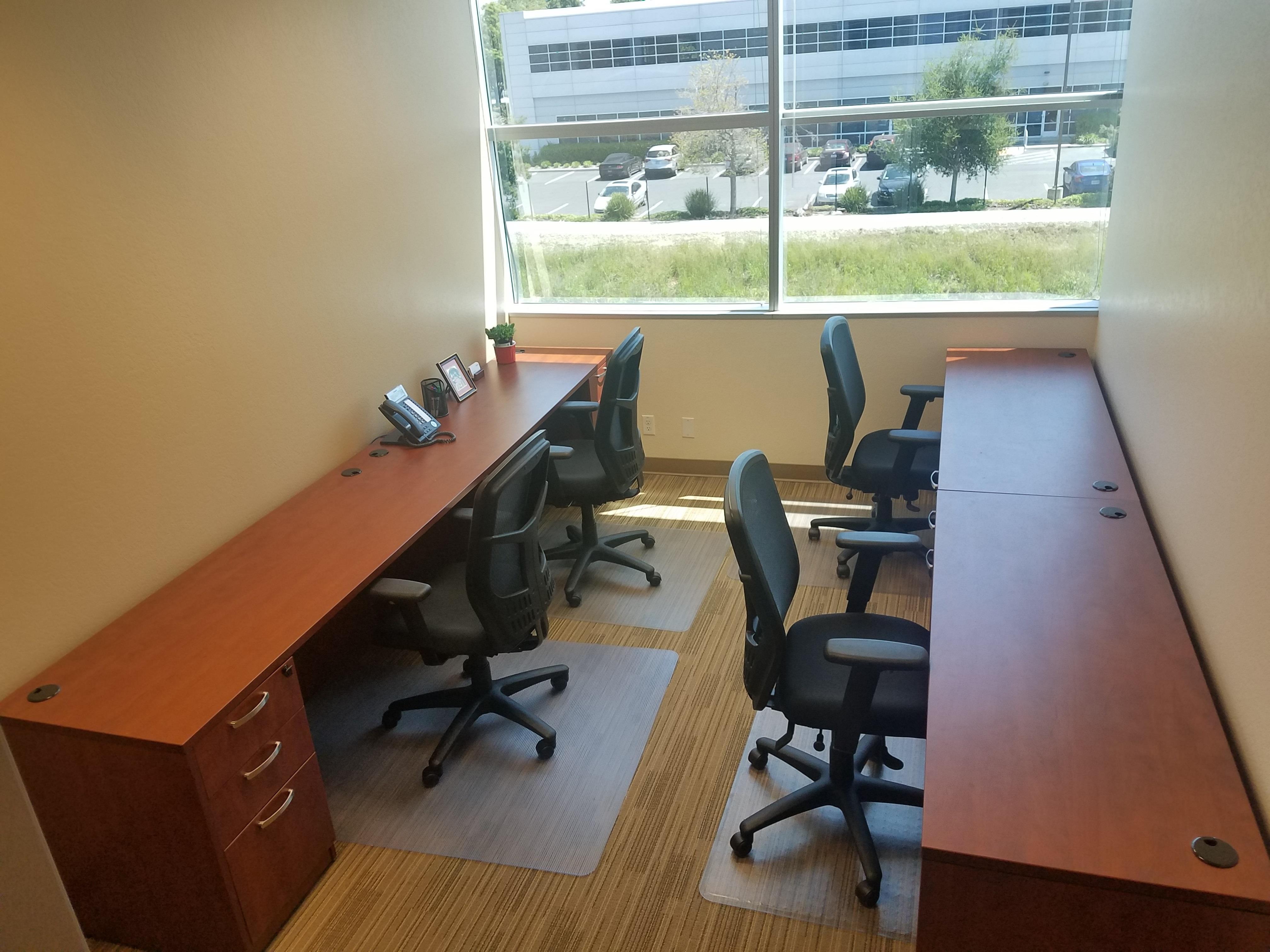 Pleasanton Business Solutions - Dedicated desk in window office