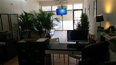 Host at Private desk space with wall divider