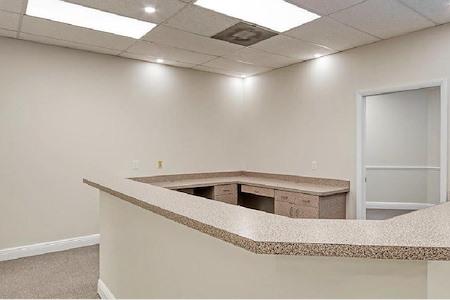 J.C. Healthcare & Associates - Medical office exam room w/ receptionist