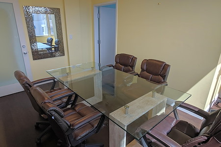 Ocean Capital Companies, LLC - Yellow Meeting Room