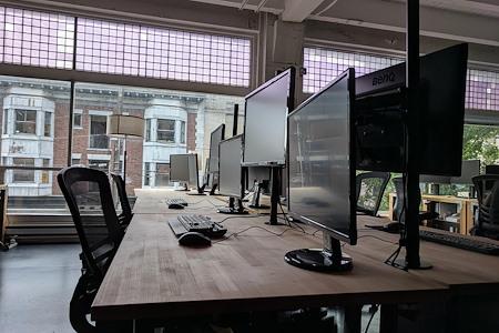 Strange Loop Games - Desk in open co-working office