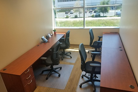 Pleasanton Business Solutions - Dedicated desk in window office