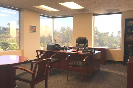 Skyline Executive Offices - Private corner office with window view!