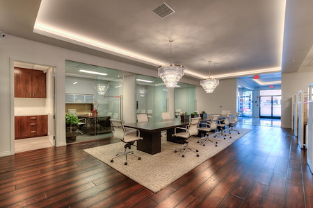 Kennedy's Realty International - Modern Open Co-working Space Rental