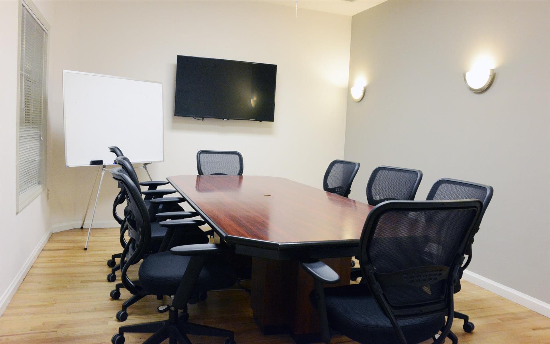 Private meeting room for 8 at select office suites chelsea for 116 west 23rd street 5th floor new york ny 10011